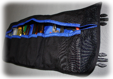 Tool pouch rolls up and fits onto moducarry carrier clips